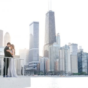 Bride and groom with cityscape background