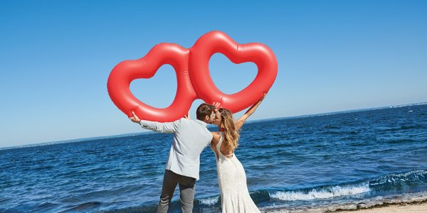Allure Couture wedding gown on the beach with heart balloons