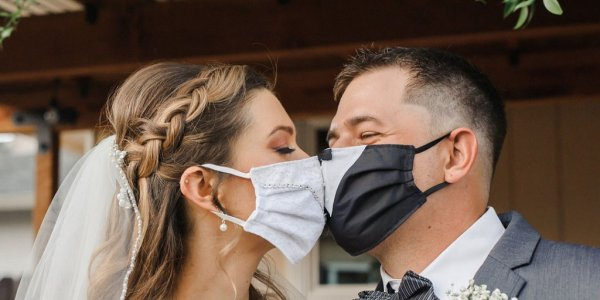 bride and groom in face masks