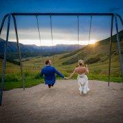 bride and groom on swings